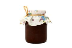 Cherry jam. Homemade cherry jam in a jar covered with color linen diaper royalty free stock photography