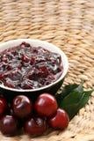 Cherry jam. Bowl of cherry jam and some fresh fruits Royalty Free Stock Photo