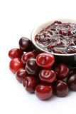 Cherry jam. Bowl of cherry jam and some fresh fruits Stock Image