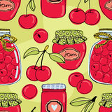 Cherry jam background. Glass jars with cherry jam Royalty Free Stock Images