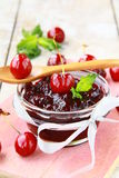 Cherry jam at bank Stock Image