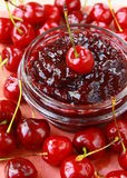 Cherry jam at bank and fresh cherries Royalty Free Stock Image