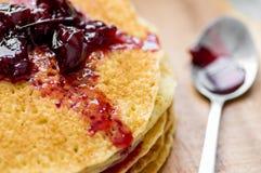 Cherry jam on blini - pancakes Stock Photography