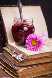 Cherry jam and flower Stock Image