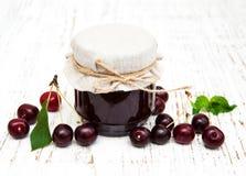 Cherry jam with fresh berries Stock Image