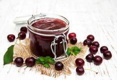 Cherry jam with fresh berries Stock Photo