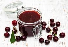 Cherry jam with fresh berries Royalty Free Stock Image