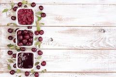 Cherry jam with fresh cherries Stock Photos