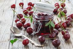 Cherry jam in a preserving glass Royalty Free Stock Images