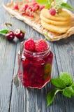 Cherry jam and raspberry Stock Images