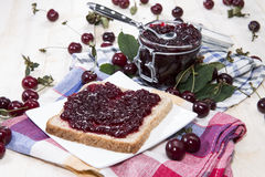 Cherry Jam Sandwich on wood Stock Photography