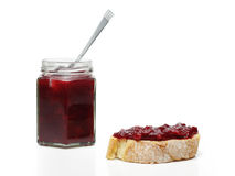 Cherry jam on slice of bread Royalty Free Stock Photo