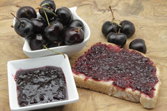 Cherry jam. Toast with cherry jam and some cherries Royalty Free Stock Photography