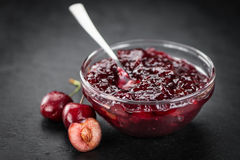 Cherry Jam on a vintage slate slab, selective focus. Some fresh Cherry Jam on a vintage slate slab, selective focus, close-up shot Royalty Free Stock Photography