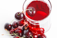 Cherry juice. Berry juice in glass isolated on white background royalty free stock photography