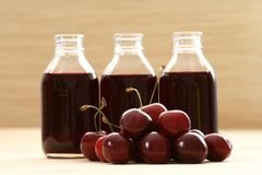 Cherry juice. Bottle of cherry juice and some fresh fruits Stock Images