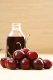 Cherry juice. Bottle of cherry juice and some fresh fruits Stock Photo