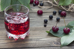 Cherry juice with berries Stock Image