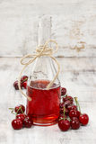Cherry juice in a bottle Royalty Free Stock Photos
