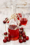 Cherry juice in a bottle Stock Image