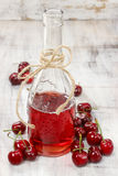Cherry juice in a bottle Stock Photos