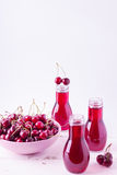 Cherry juice in bottles. Stock Photography