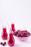 Cherry juice in bottles. Royalty Free Stock Images