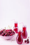 Cherry juice in bottles. Stock Image