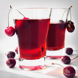 Cherry juice with cherries. Cherry juice with fruits in high-key. Shallow depth of field Stock Photos