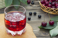 Cherry juice , cherry and currant Stock Photo