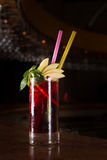 Cherry juice cocktail. On the bar stand with dark background. Shallow DOF Stock Image
