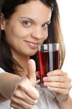 Cherry juice is consumed from a glass Stock Images