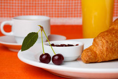 Cherry with juice and croissant Royalty Free Stock Image