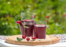 Cherry with juice on cutting board Stock Photography