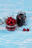 Cherry juice with glass of berries Stock Image