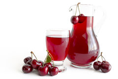 Cherry juice in glass and carafe Stock Photo