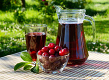 Cherry juice in a glass and carafe Royalty Free Stock Photos