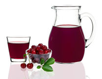 Cherry juice in a glass and carafe Stock Photos