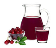 Cherry juice in a glass and carafe Stock Images