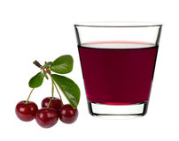 Cherry juice in a glass with cherries Royalty Free Stock Image