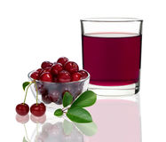 Cherry juice in a glass with cherries Royalty Free Stock Photos