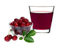 Cherry juice in a glass with cherries Stock Photos
