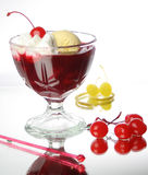 Cherry, juice and ice cream. Ice cream with cherries and juice in the cristal glass Royalty Free Stock Photo