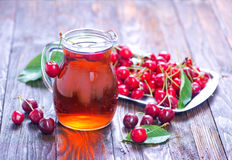 Cherry juice. In jug and on a table Stock Image