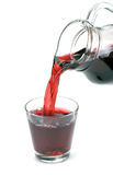 Cherry juice is poured Royalty Free Stock Photos