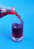 Cherry juice pouring Stock Photography