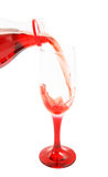 Cherry juice pouring isolated Stock Images