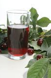 Cherry juice and red cherries. Cherry juice and some sweet red cherries Royalty Free Stock Photo