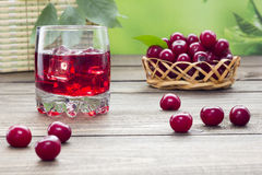 Cherry juice. On a table in the early morning Stock Photos
