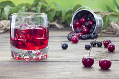 Cherry juice. On a table in the early morning Stock Image